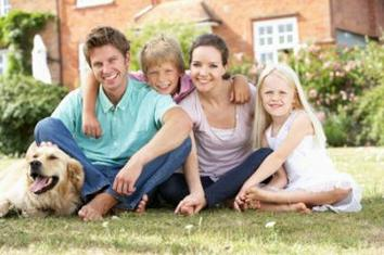 happy family - 2 adults 2 children and a dog